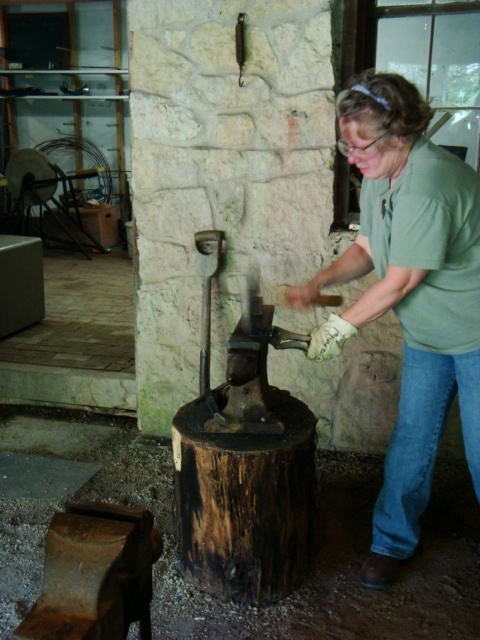 Donna at the anvil in 2010 blacksmithing class.