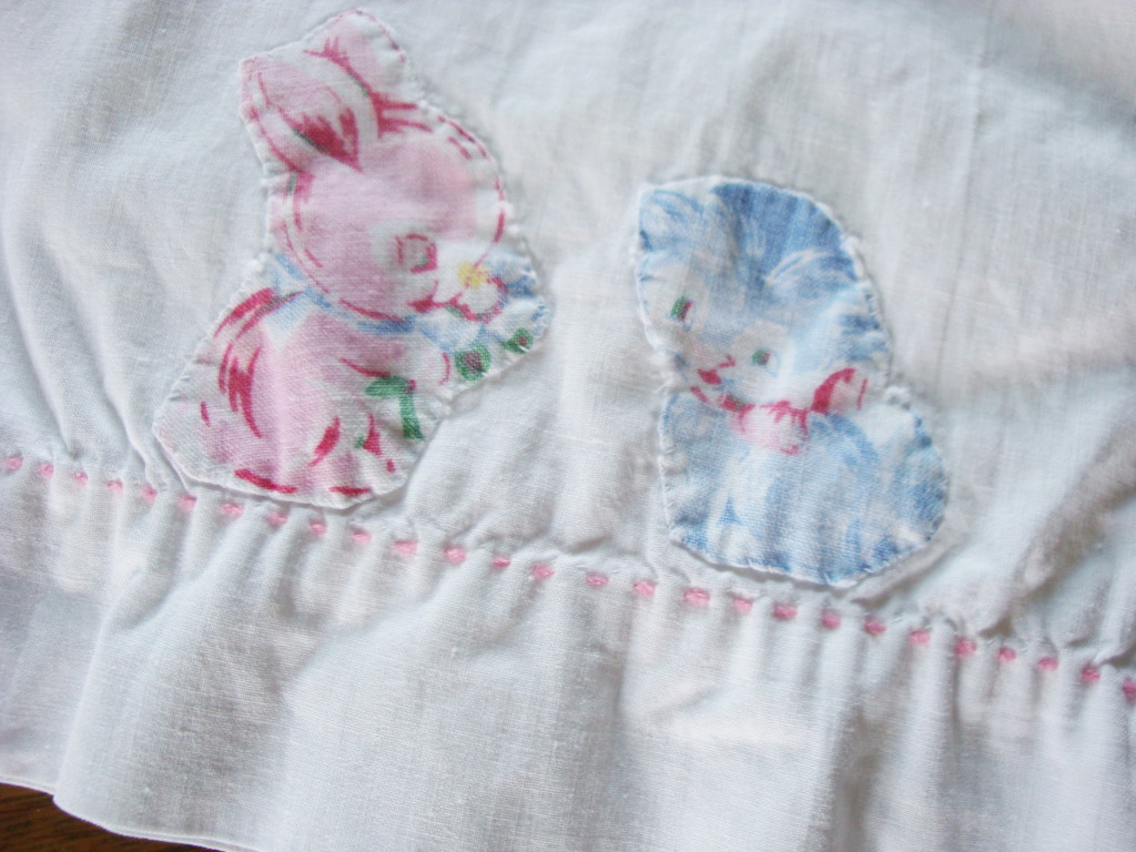 Appliqued and embroidered baby pillowcase.
