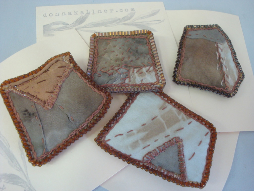 Pins made with naturally dyed silk fabrics by Donna Kallner.