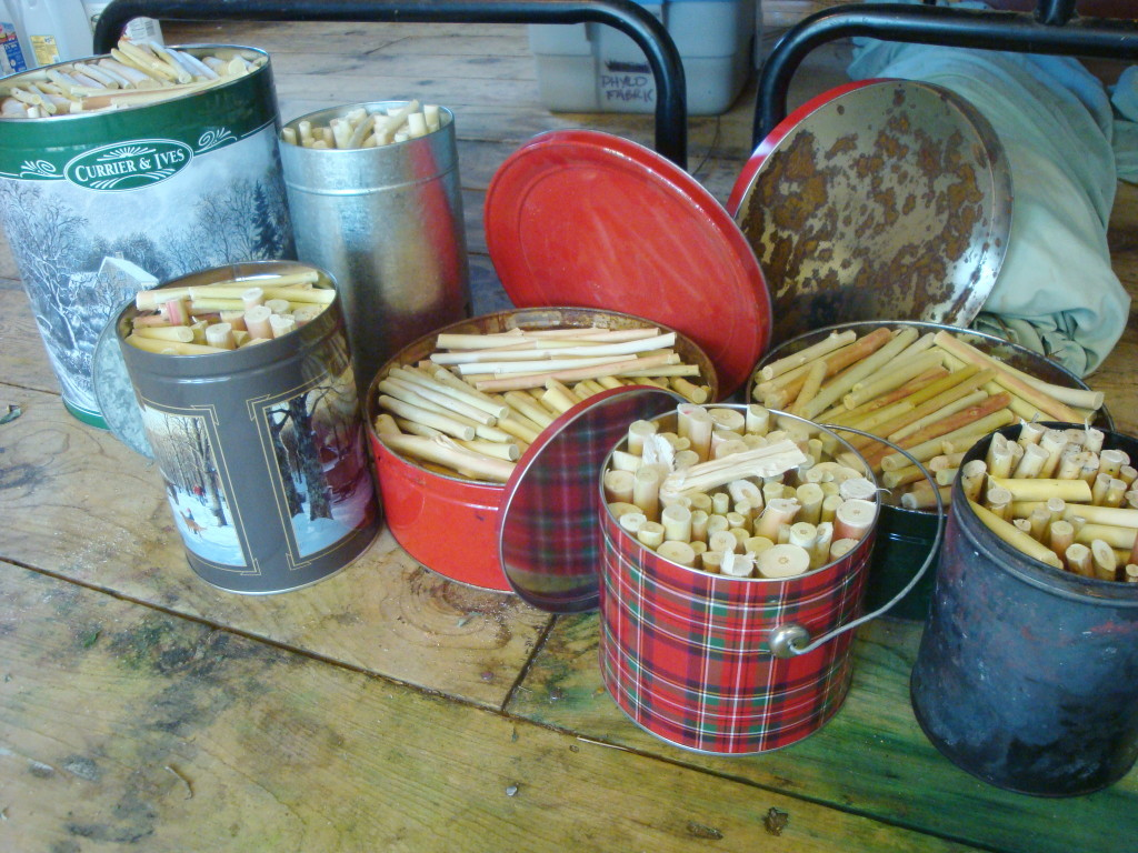 Tins of peeled willow ready to burn into charcoal for drawing.