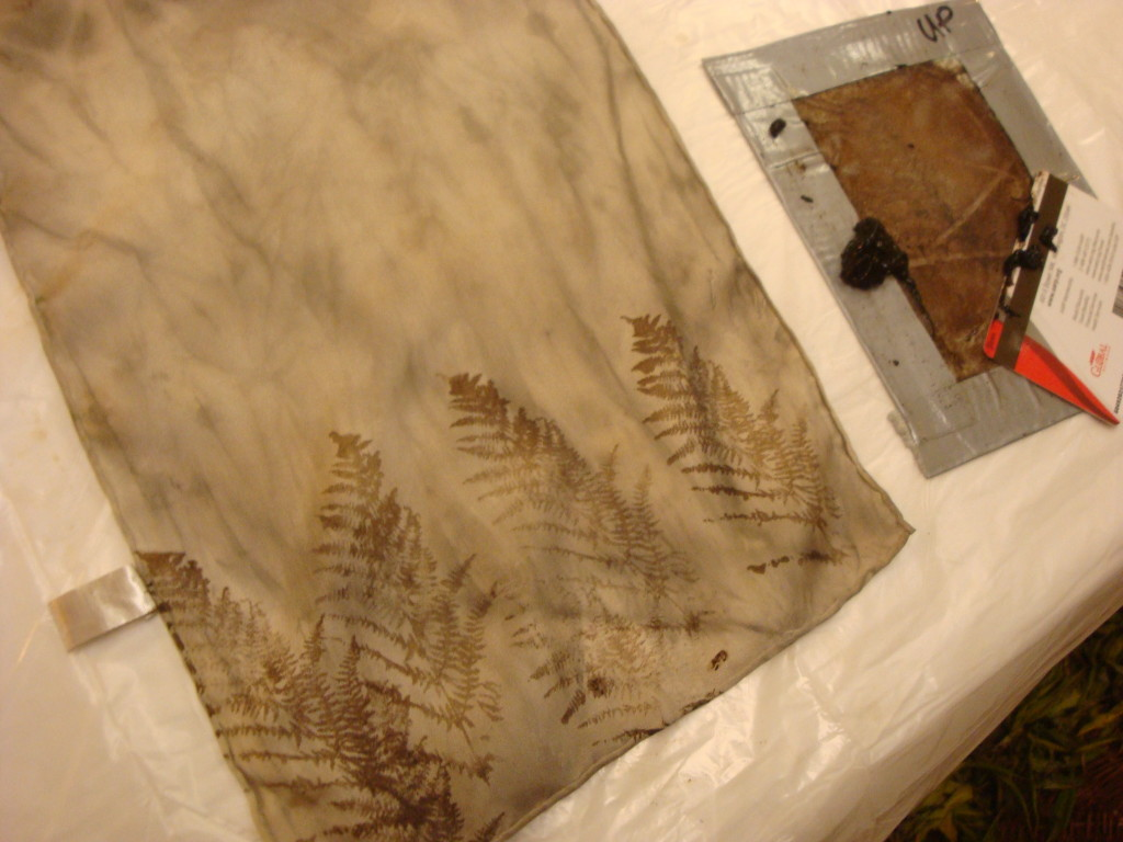 Thickened walnut dye screen printed on silk scarf by Donna Kallner.